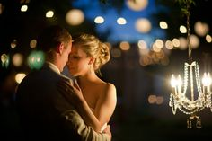 Lighting is everything in creating fabulously romantic ambiance and backdrops for great pictures! Love the blurred string of lights and the chandelier.