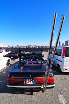 Black car exhaust fetish garage girl pipe spot wall