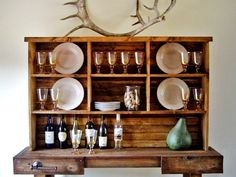 An open dining area hutch offers a place to display beautiful serving pieces and glassware. Using solid pine boards, you can make this DIY version in just a few hours.