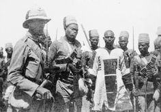 Anglo-Sudan War, 1898-99: Emir Mahmoud, leader of the Sudanese (Dervish) forces is captured at the Battle of Atbara. He is shown with a prisoner escort formed of men from the 10th Sudanese Battalion. The bloodstains on his jibba are from a bayonet wound to his left leg. Mahmoud was imprisoned at Rosetta and died in 1906.