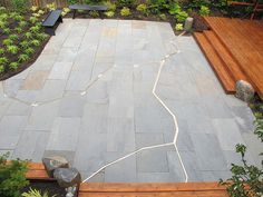 JCCCW Kintsugi Garden The plaza is composed of bluestone pavers surrounding a brass inlay stretching across its entirety. Symbolic of the 500 year-old Japanese practice of mending broken pottery with gold – Kintsugi, the garden's namesake – the brass embraces the philosophy of recognizing the history and spiritual significance of a material by visibly incorporating the repair into the new piece, instead of disguising it.