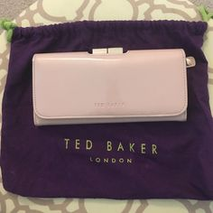 Ted Baker nude pink wallet Greatly loved gorgeous Ted Baker nude pink wallet. Wallet is used & have some scuff marks. Interior crease has cracks on both ends. However all Ted Baker wallets are made with care and can last a long time. I've also price adjusted for the wear in the wallet. This wallet is amazing with the storage: 7 credit card slots and 1 ID slot and full inner pocket along top; 4 credit card slots on bottom with 2 slots for cash and another 2 slots for cash inside clasp pocket…