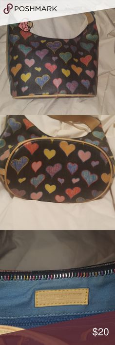 Dooney and Bourke Hobo This colorful heart shaped hobo purse is very well conditioned. As seen on the last picture it has a couple stains inside, but can easily be wiped down. No flaws, stains or rips on the outside. Dooney & Bourke Bags Hobos