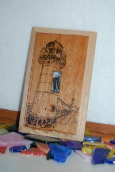 Switch plate cover wood burned with lighthouse. Comes with screws. Can match outside border to match your own decor...stain or paint.