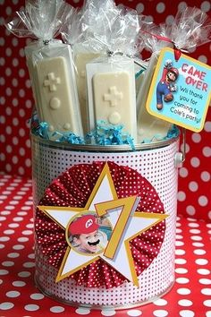 These chocolate favors from Amy's Party Ideas were for a Super Mario party.   The chocolate was made using a specialty Wii Controller candy mold.  The chocolates were wrapped in cellophane and tied with ribbon.   A custom thank you card was attached and the chocolate was placed in decorated Super Mario display.