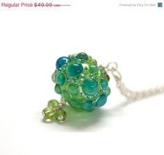 Lampwork Apple Splash Hollow pendant with peridot handmade by FenG beads