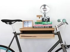 If+you're+a+biker+living+in+an+apartment,+you+probably+know+how+difficult+it+is+to+keep+your+prized+possession+safe+from+harm+as+well+as+out+of+the+way.+But+with+this+nifty+bike+shelf+from+Knife+&+Saw,+your+bike+can+shine+in+its+own+home,+off+of+the+floor+and+out+of+the+way.