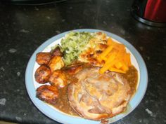Minced ground beef  pie with cabbage, carrots and roast potatoes