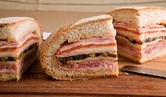 HOW TO MAKE MUFFULETTA [VIDEO] Watch how to make a classic muffuletta sandwich. Made famous in New Orleans, this 5-star sandwich is loaded with deli meats and cheeses and features a spicy olive salad that's spread on round Italian bread.