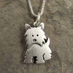 Just a warning....it is tiny. Westie necklace Found it on: http://www.etsy.com/listing/99149385/westie-necklace?ref=sr_gallery_7_search_query=westie+necklace_view_type=gallery_ship_to=US_search_type=all