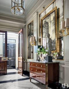 A fifth-century Chinese lohan figure stands on an antique Northern European commode from Newel in the entrance hall of a Manhattan townhouse transformed by design firm Sawyer | Berson. Not surprisingly, the space is featured in our roundup of the most impressive entryways | archdigest.com