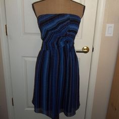 Strapless NWT dress by Sangria Beautiful strapless dress NTW from Macy's . Size 10, polyester with silk lining . Black purple and blue perfect for spring or summer , knee length Sangria Dresses Strapless
