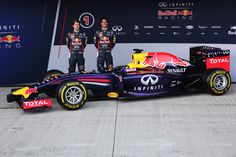 Infiniti Red Bull Racing drivers Sebastian Vettel (R) of Germany and Daniel Ricciardo (L) of Australia unveil their new RB10 Formula One car at the Circuito de Jerez on January 28, 2014 in Jerez de la Frontera, Spain. (Photo by Andrew Hone/Getty Images)