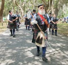 Photos by Joseph Jacob/ Savannah Morning News/ Members of the Savannah Pipe and Drum Corps play as they march around the main walkway of Bethesda Academy during the 37th annual Savannah Scottish Games./  Savannah Morning News