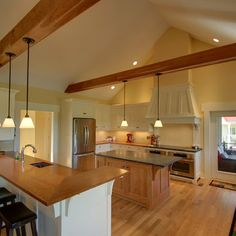 Kitchen. Love the lights coming from the exposed beams
