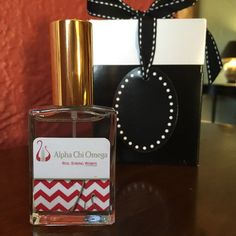 Hey Alpha Chi Omega's!   Check out your NEW flirty, chic Sorority Perfume with your exclusively designed bottle of scarlet red and olive green. The Alpha Chi lyre has been incorporated into the design. Enjoy! ~Deborah, Certified Perfumer, owner Sorority Perfume