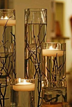 Floating candles + twigs = brilliant!
