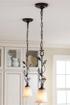 Bronze Mini Pendant Light with Amber lily glass shade with a dark oil-rubbed bronze finish.