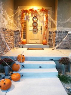 Halloween front porch - follow the spiders. Or mice.