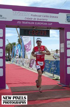 Philip Hatzis crosses the finish line in just over one hour in the Quateira Triathlon ETU
