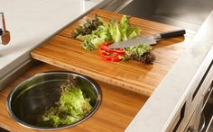 """Prepping a salad has never been easier! The lettuce and peppers are chopped and prepared on the Dual-tier Cutting Board to effortlessly slide into the salad as sits in the 11"""" Deluxe Bowl in the Dual-tier Platform."""