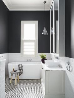 Beautiful and modern black and white bathroom with white subway tiles from Dulux colour gallery. Love the detailing on the floor! Black White Bathrooms, Black And White Tiles, Grey Bathrooms, Bathroom Black, White Walls, Black Walls, Half Bathrooms, Black And White Bathroom Ideas, Black Bathtub