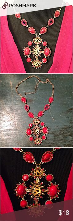 """30% OFF BUNDLES! ❤️Red Beaded Pendant Necklace❤️ So gorgeous to wear on your neckline. This vibrant red necklace has oval beaded & crystal accent shapes on the sides and a drop attached pendant with more red beading & adorable leopard accent stones. The red color is best represented in pic #3.  16"""" L with 3"""" extender & lobster claw clasp. Drop pendant is 2.5""""L x 2.25""""W. Great quality gold tone. NWOT Excellent Condition. boutique Jewelry Necklaces"""