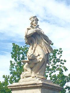 Roma, Italy. Statua del Glorioso Martire San Giovanni Nepomuceno collocata sul Ponte Milvio che attraversa il Tevere.
