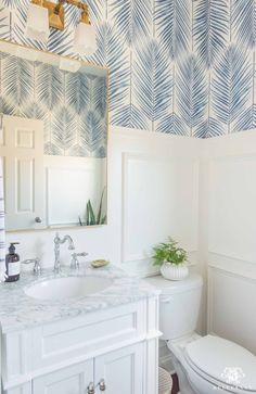 Check out all the decor and design details for this small, modern coastal powder room transformation, along with the befores and afters! Coastal Powder Room, Tiny Powder Rooms, Modern Powder Rooms, Powder Room Decor, Powder Room Design, Blue Bathroom Decor, Bathroom Design Small, Bathroom Interior, Downstairs Bathroom