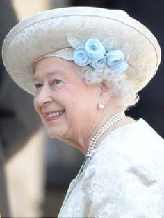 The Queens hat was a departure from her usual style, trimmed with pale blue silk chiffon flowers