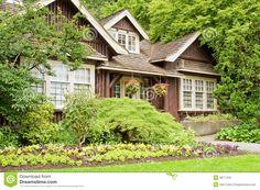 Landscaped Log Cottage In Woods Royalty Free Stock Image - Image: 9871416