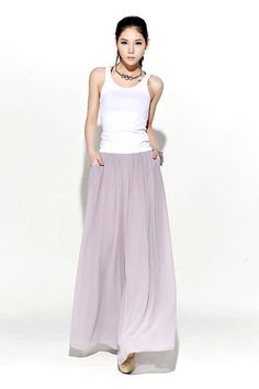 Understated but oh-so elegant, these beautifully streamlined gray chiffon palazzo pants are made in whisper-soft chiffon. Designed to flatter and create a wonderful silhouette no matter what size or shape you are. These chiffon palazzo pants would make a wonderful and slightly alternative