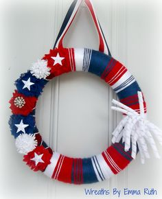 Fun Patriotic Red White Blue 4th of July Yarn Wreath with Korker Ribbon. via Etsy.