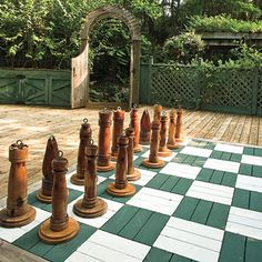Game Inspired Patio | Chess pieces the size of children await visitors' opening move on this game board patio.