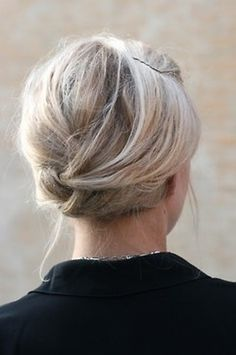 For shorter hair that doesn't work well for a large updo, you can create this look by interweaving and pinning random sections of hair.
