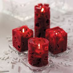 Decorate with lacy candles made using milk and juice cartons as molds, and ice.