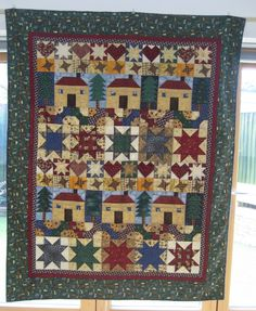 Sew A Row quilt. Debbie Mumm fabrics. Quilted by machine, in the ditch.