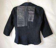stitched thread on black shirt