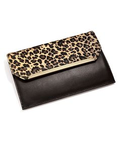 Gen. Leather & cowhide Clutch with detachable strap! Magnetic snap closure. More info & to order visit mysilpada.com/Lisa.bloedel