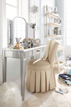 Make someone on your gift list feel glamorous with the Hayworth Silver Vanity Table from Pier 1. Handcrafted, hand-painted and covered with bevel-cut mirrored glass, it can serve as a dressing table or a small desk. Add the folding mirror, available separately, and it becomes a great place to apply makeup. By the way, you're pretty glamorous yourself. Why not put it on your own gift registry?