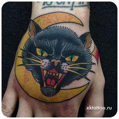 Black cat tattoo. Tattoo by Dmitry Rechnoy (Re4noy). XKtattoo studio.