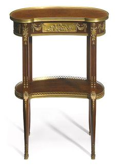 A Louis XVI style gilt bronze mounted mahogany table ambulent <br>possibly Francois Linke <br>late 19th century