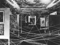 Marcel Duchamp: Mile of String  (1942) In 1942, Andre Breton organised a retrospective exhibition of Surrealist art in New York: First Papers of Surrealism. For the vernissage Marcel Duchamp created this installation - a gigantic web - called the Mile of String. He and Breton furthermore arranged for a number of children to ball in the room thereby making it very difficult for the guests to see the paintings.