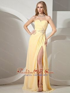 Sweetheart Neckline High Slit Yellow Prom Dress  www.fashionos.com  Fitting bodice design with a sweetheart neckline and beaded decoration makes the gown so beautiful and sexy that you can gain more attention and no matter what you attend,you will become the spotlight.Besides,the gorgeous skirt is accented with the dramatic and dainty beadwork throughout the waist part.The slit can show the beauty of your leg. A hidden zipper on the side makes for easy off and on and secures the dress in…