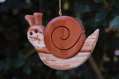 More than 60 different designs available. Each of our handmade carved ornaments is made from five different native woods, including redwood, western red cedar, Alaskan yellow cedar, port orford cedar, and incense cedar. Because of this each has a unique aromatic scent. We then Port Orford Cedar, Western Red Cedar, Oregon Coast, Wood Colors, Snail, Driftwood, Nativity, Cowboy Hats, Cheer