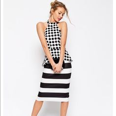 Asos Halter dress in stripe and spot Sz6 Gorgeous Asos dress with open back detail. Dress is enhanced with beautiful peplum waistline. Great condition! Worn once for a wedding and now it's time to pass it on. ASOS Dresses