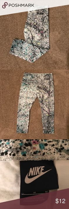 Spatter Paint Nike Leggings Spatter Paint Nike Leggings The fit is a Capri length, tight fit. Worn maybe 1-2 times. Nike Pants Leggings