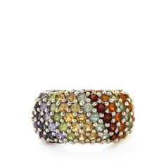 An alluring Ring from the Annabella collection, made of Sterling Silver featuring 4.94cts of beautiful Red Garnet, Amethyst, Iolite, AA clarity Tanzanite, Russian Apatite, Hunan Peridot, Citrine and American Fire Opal.