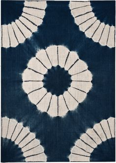 Japanese tie dye: Kumo Shibori is a pleat and bound resist technique of shibori. Small sections of fabric are pleated very finely, or wrapped around small objects such a pebbles and bound very closely. Kumo results in a specific spider-like design.