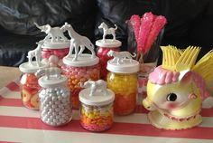 Take the candy bar at your next party to a new level with this DIY project. All you need are some Mason jars, plastic toy animals, and paint. Get the tutorial on Things I Should Do.   - CountryLiving.com